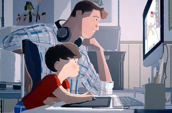 Vater mit Sohn am Computer